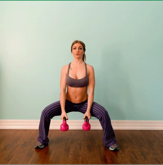 Sumo Squat with side arms raise - 8 Exercise That Will Burn Inner Thigh Fat