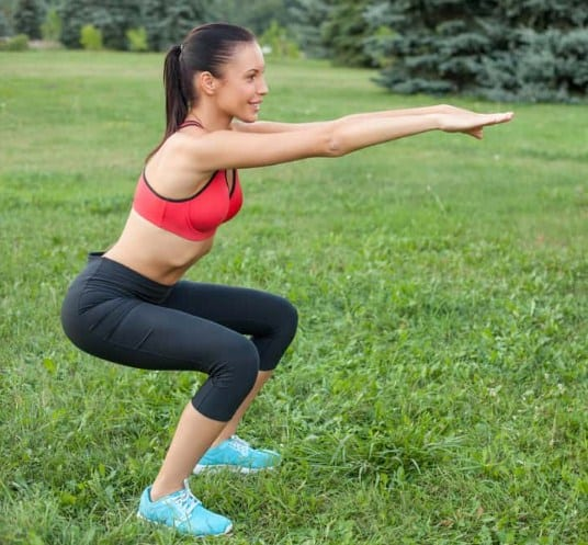 Squats - 8 Simple Exercises to Lift Sagging Breasts And Make Them Firm