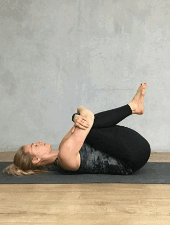 Knee-to-chest Pose to deal with menstrual pain