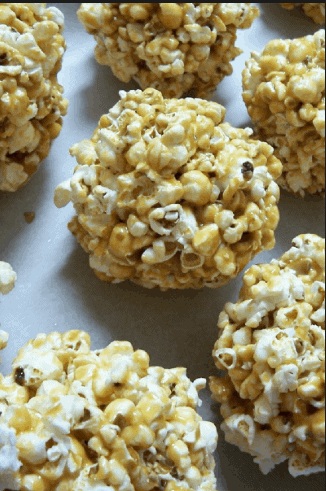 Sticky Sweet Popcorn Balls- 8 amazing Halloween Recipe that will satisfy your sweet tooth